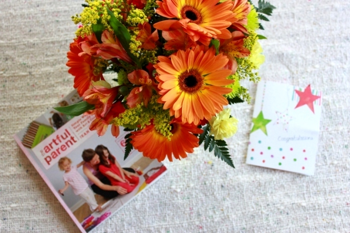 The Artful Parent book and flowers