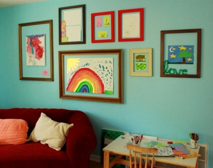 Maia's even larger rainbow painting on foamcore is also tacked onto ...