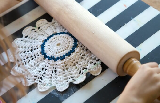 Making lace prints with crochet doilies