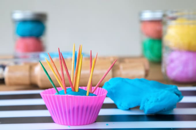 Playdough in cupcake liner with toothpicks