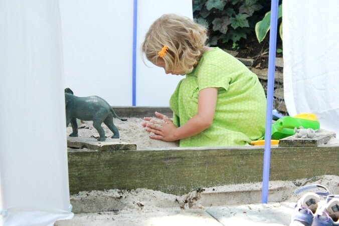 Playing in the Sandbox Under the Playhouse