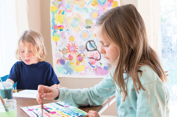 kids painting at a table - kids art spaces
