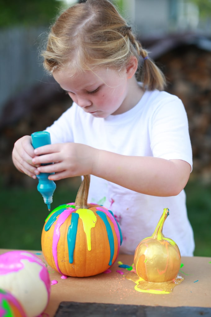 squeezing paint onto pumpkin _ rachel withers