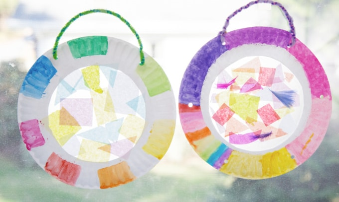 tissue paper suncatchers hanging in the window
