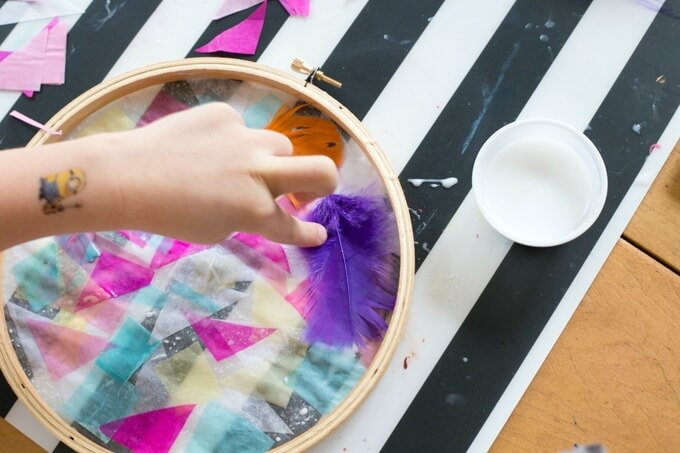 Daphne working on a tissue paper suncatcher