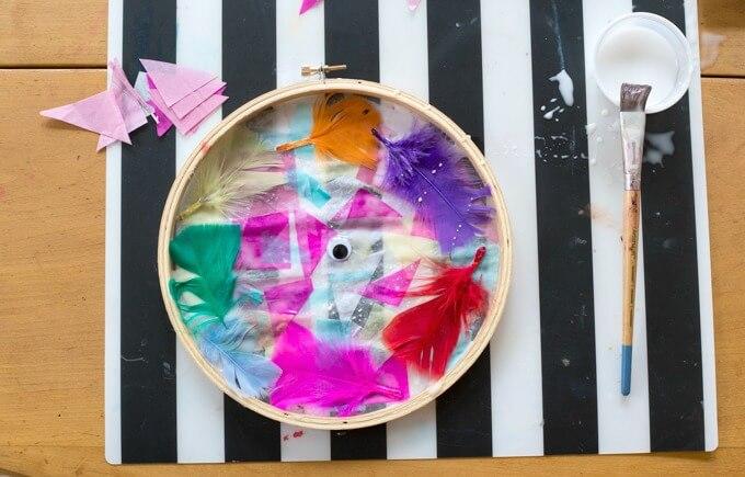 Tissue paper suncatchers in embroidery hoop frames
