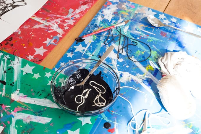 Covering string with paint for the pulled string art activity