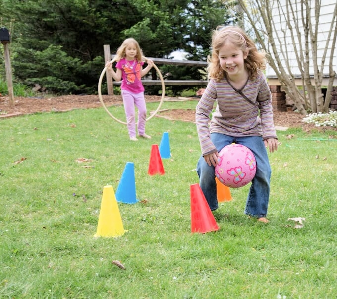 children playing in backyard obstacle course