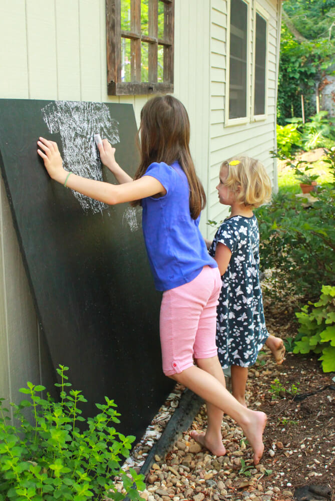 Rubbing a new homemade chalkboard with chalk