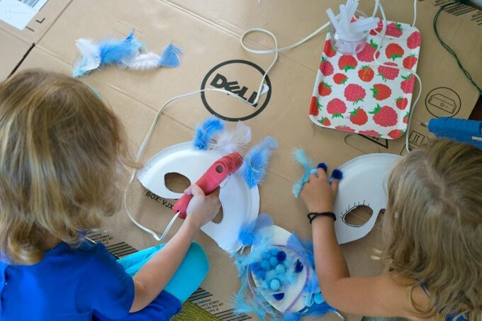 Adding embellishments to paper plate masks