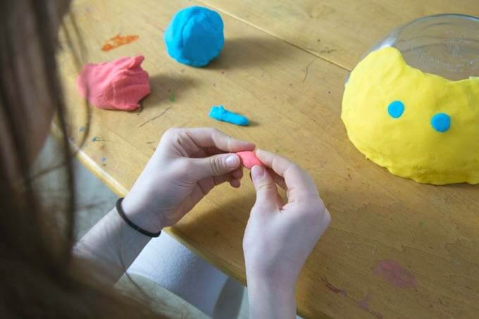 Make Playdough Faces on Upturned Bowls