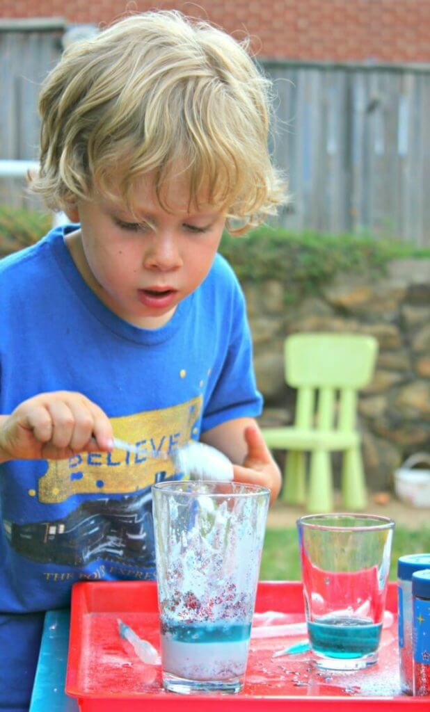 Sensory Play with Glitter Potions - E Stirring