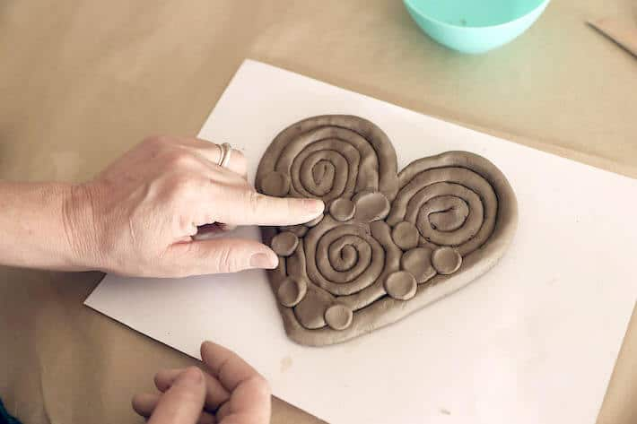 Adding finishing touches to Clay Coil Heart