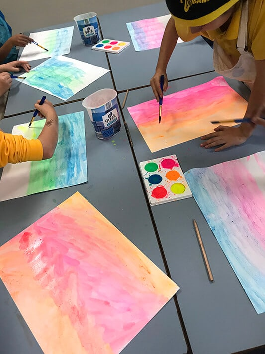 Painting the background on marble paper art project