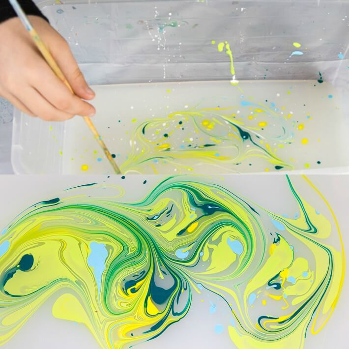 Paper Marbling with Acrylic Paint - Swirling the paint for a marble effect