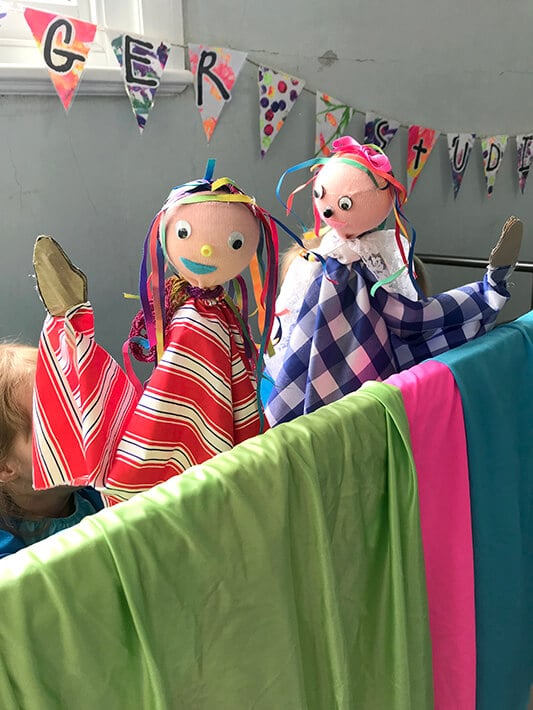 Two hand puppets during kid's puppet theater