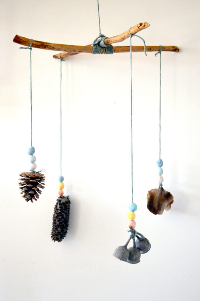 Finished nature mobile hanging with clay beads and found nature objects