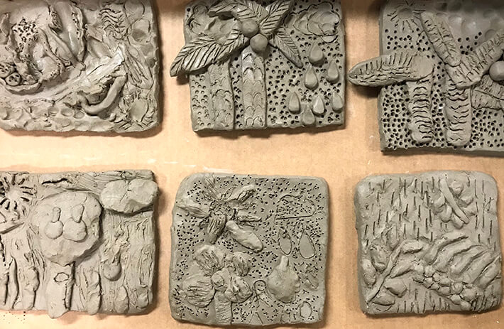 Carved clay relief tiles