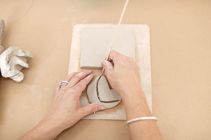 Step 3 – Cutting clay with skewer for clay relief tiles