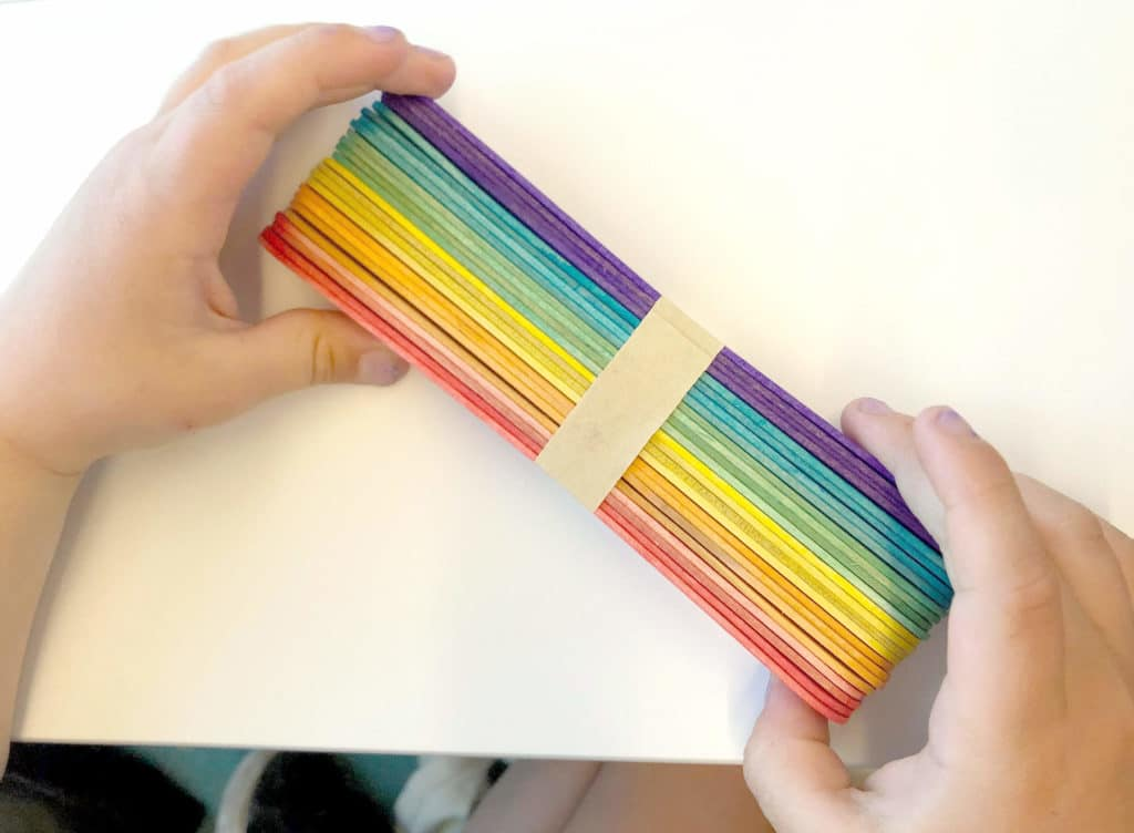 Rainbow popsicle sticks for open ended art activity while traveling with toddlers