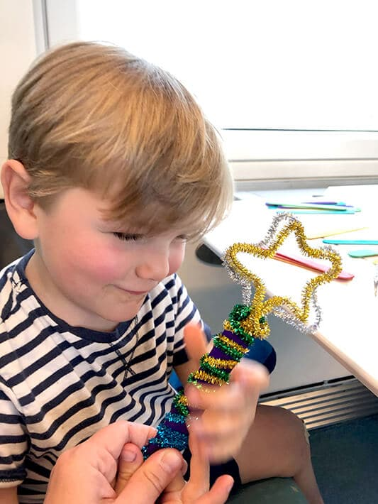 Traveling with toddlers – boy with star wand made out of pipe cleaners