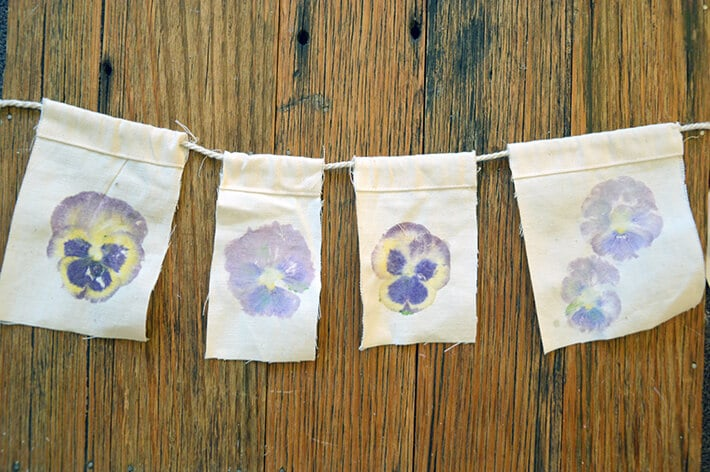 Create these beautiful flower flags by flower pounding on canvas