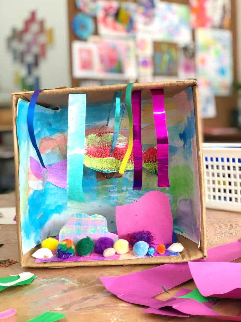 Fish, seaweed, rocks make up a colorful underwater shoebox dioramam