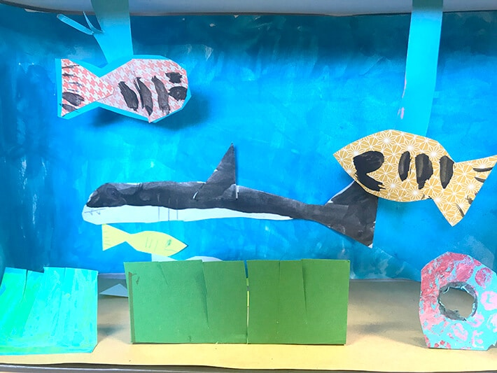 Underwater themed shoebox diorama with shark and fish