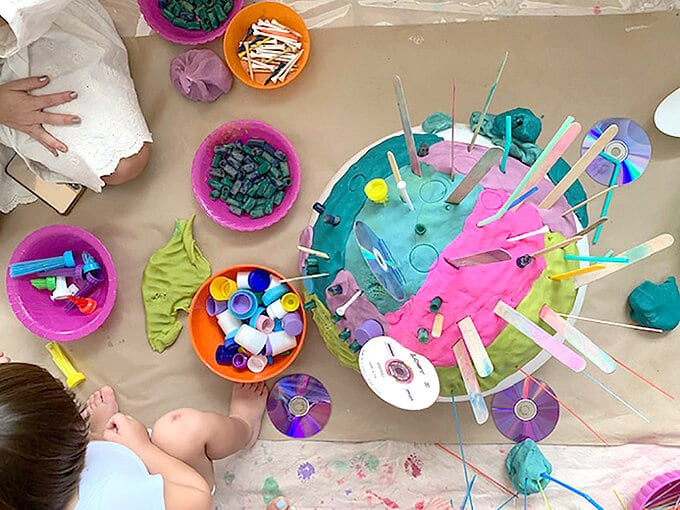 Playdough play with toddlers including craft sticks, cds, and recycled lids
