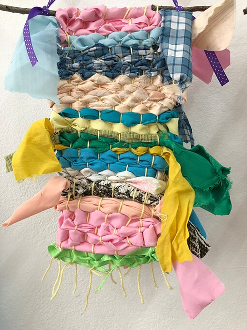 Beautiful fabric and ribbon weaving for kids on a cardboard loom