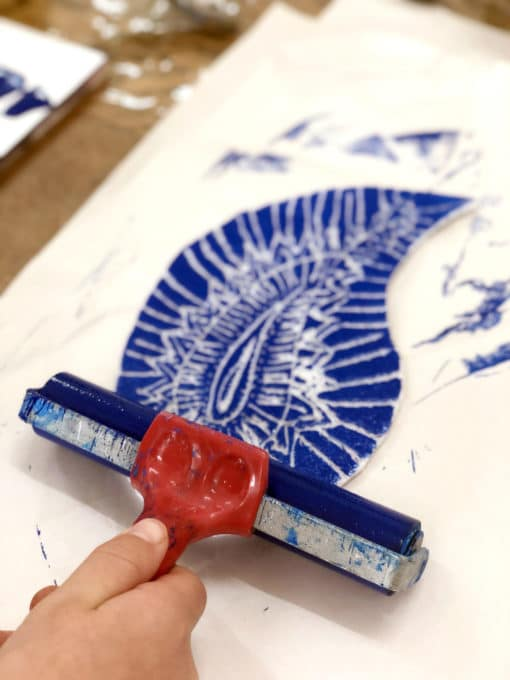 Rolling brayer on scratch foam printing plate