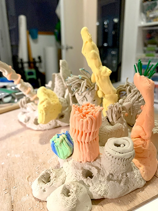 Orange and yellow coral reef made of clay