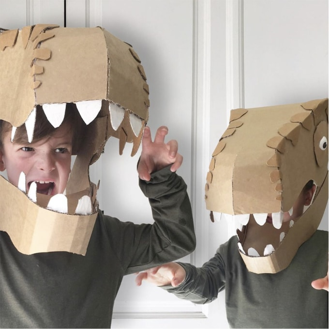 Two boys wearing cardboard dinosaur costumes from Zygote_Brown