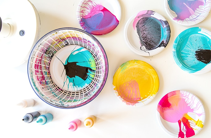 Spin art for kids with squeeze bottles of paint.