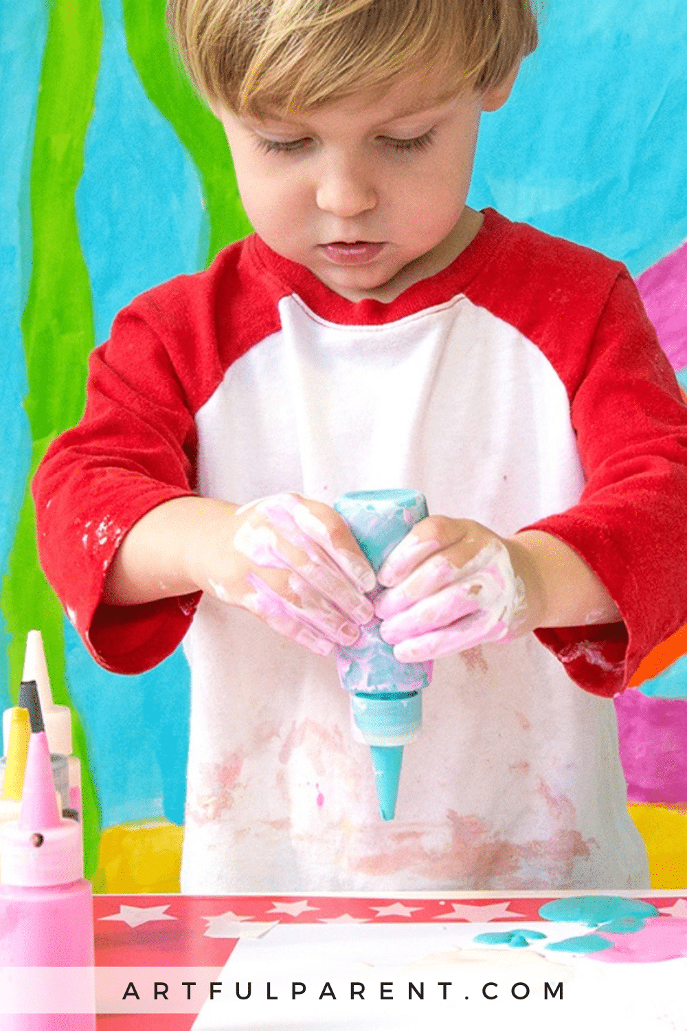 Toddler with squeeze paints