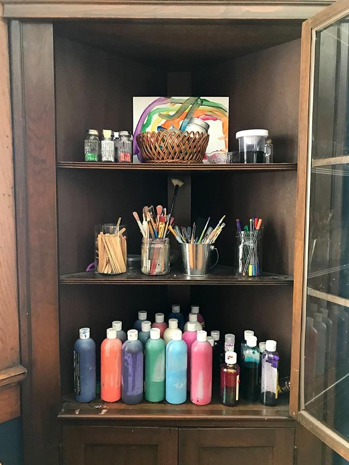 Art supplies in corner cabinet